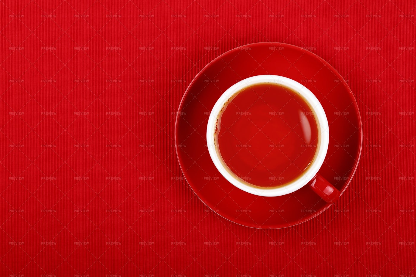 Cup Of Black Tea Against Red: Stock Photos