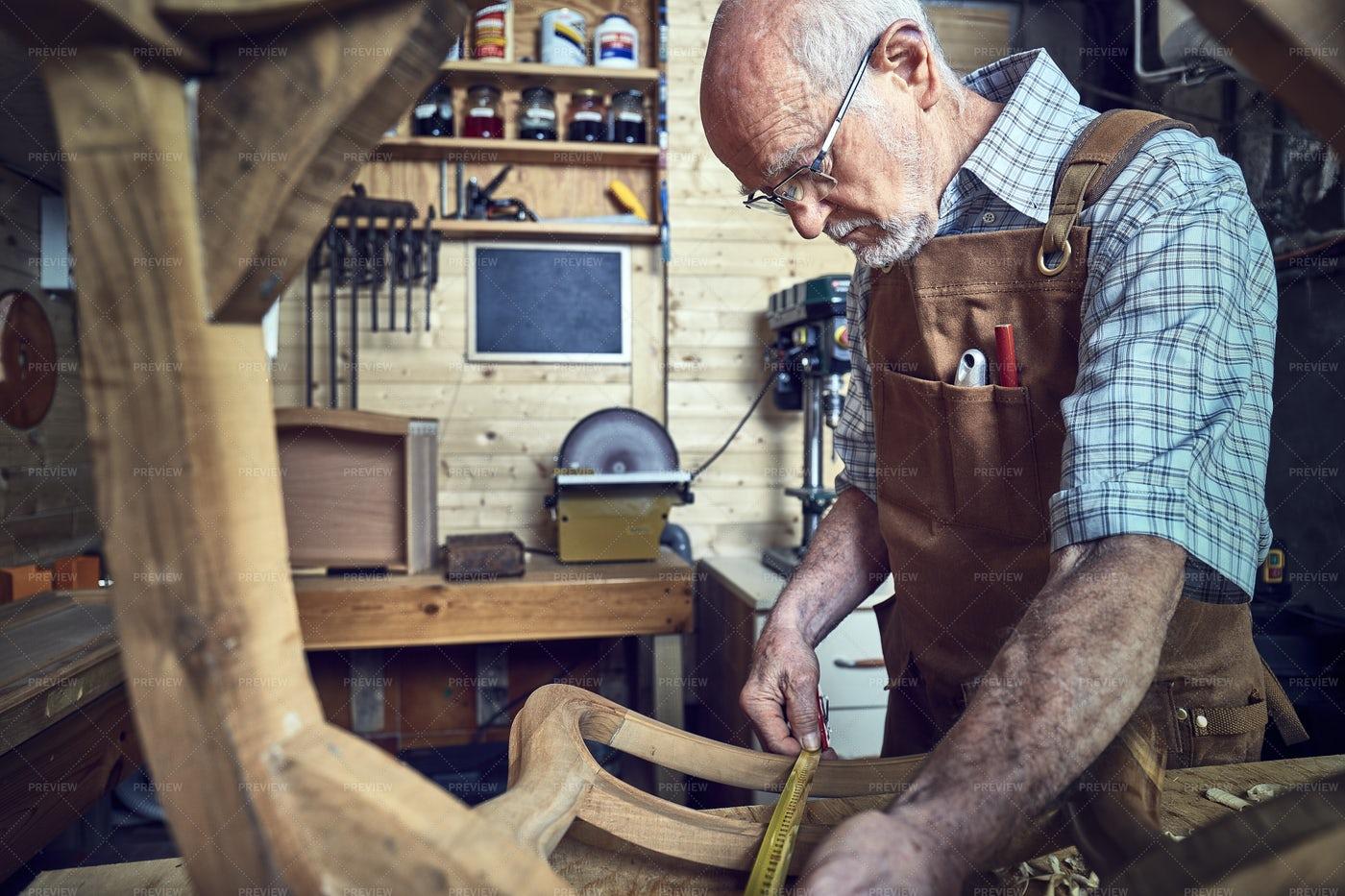 Old Carpenter At Work: Stock Photos