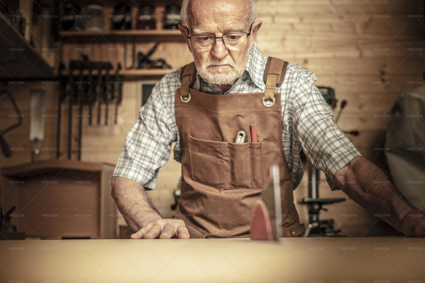 Carpenter With Tablesaw: Stock Photos