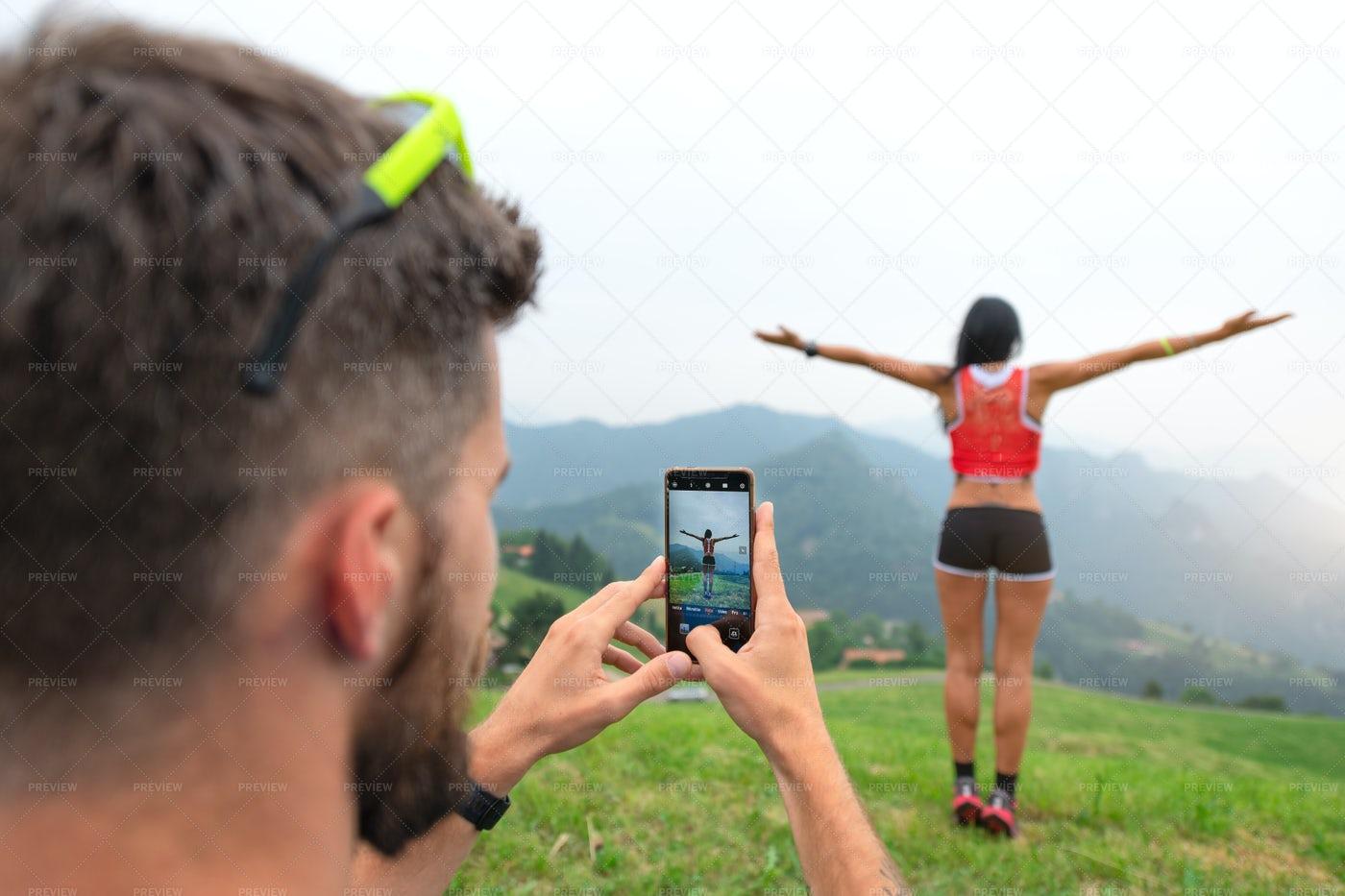 Man Photographs A Sporty Woman: Stock Photos