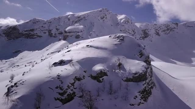 Aerial View Of Snowy Mountain: Stock Video
