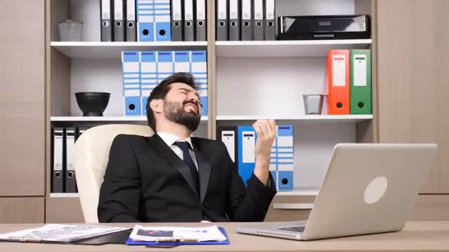 Businessman Relaxing At The Office: Stock Video