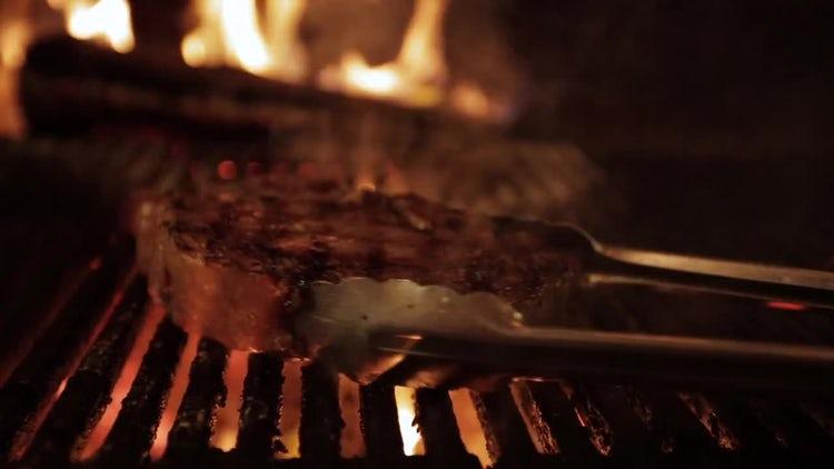Burning Ribeye Steak On Grill: Stock Video