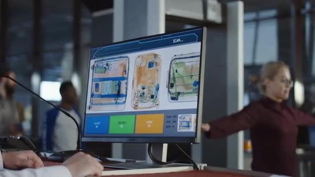 Employee Exploring Baggage Through X-ray: Stock Video