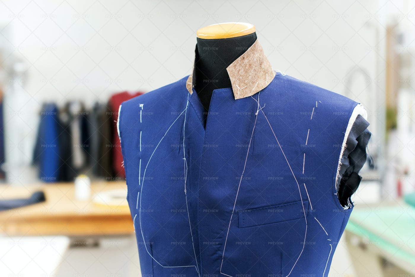 Partially Completed Blue Jacket: Stock Photos