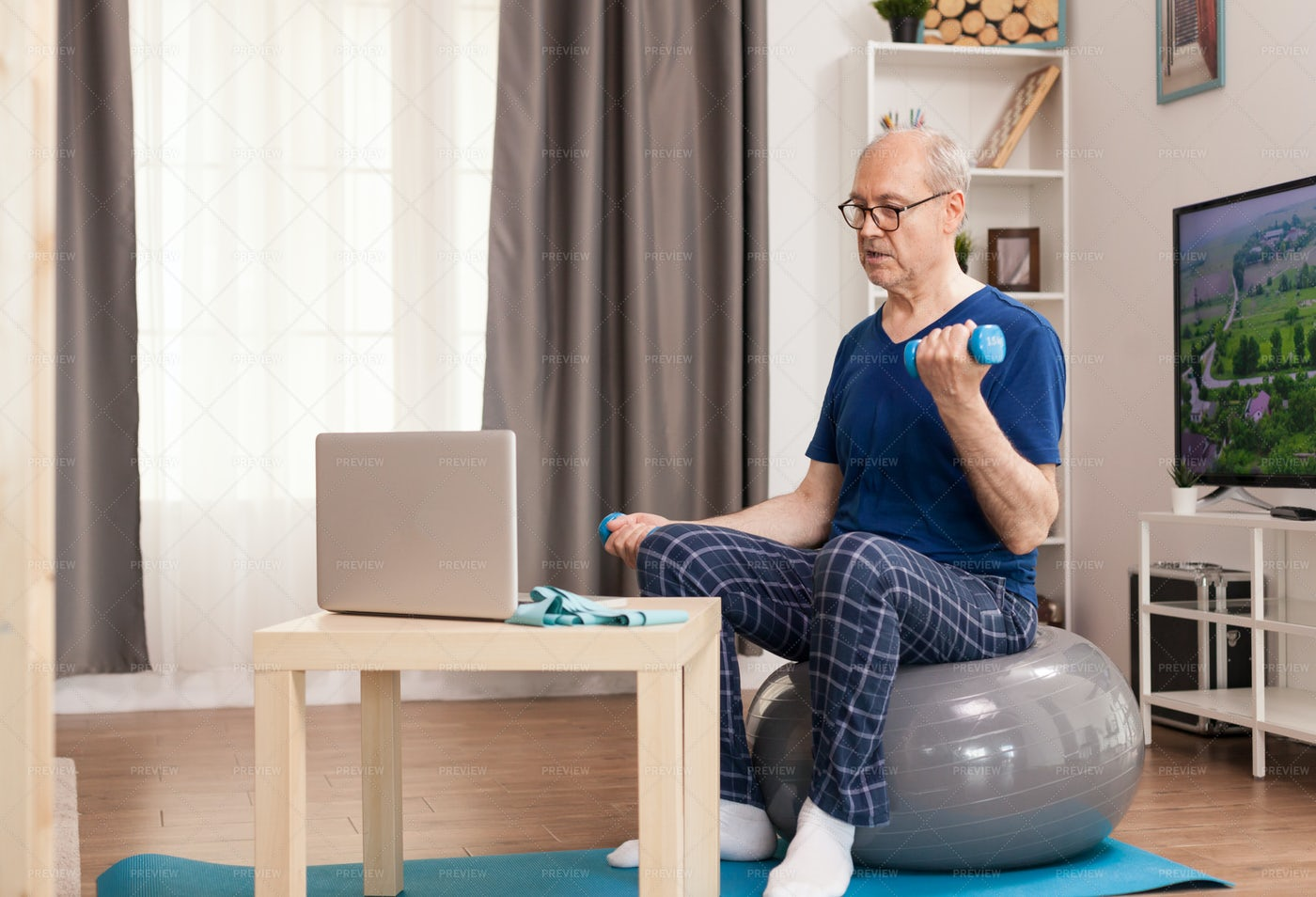 Old Man Training With Online Coach: Stock Photos