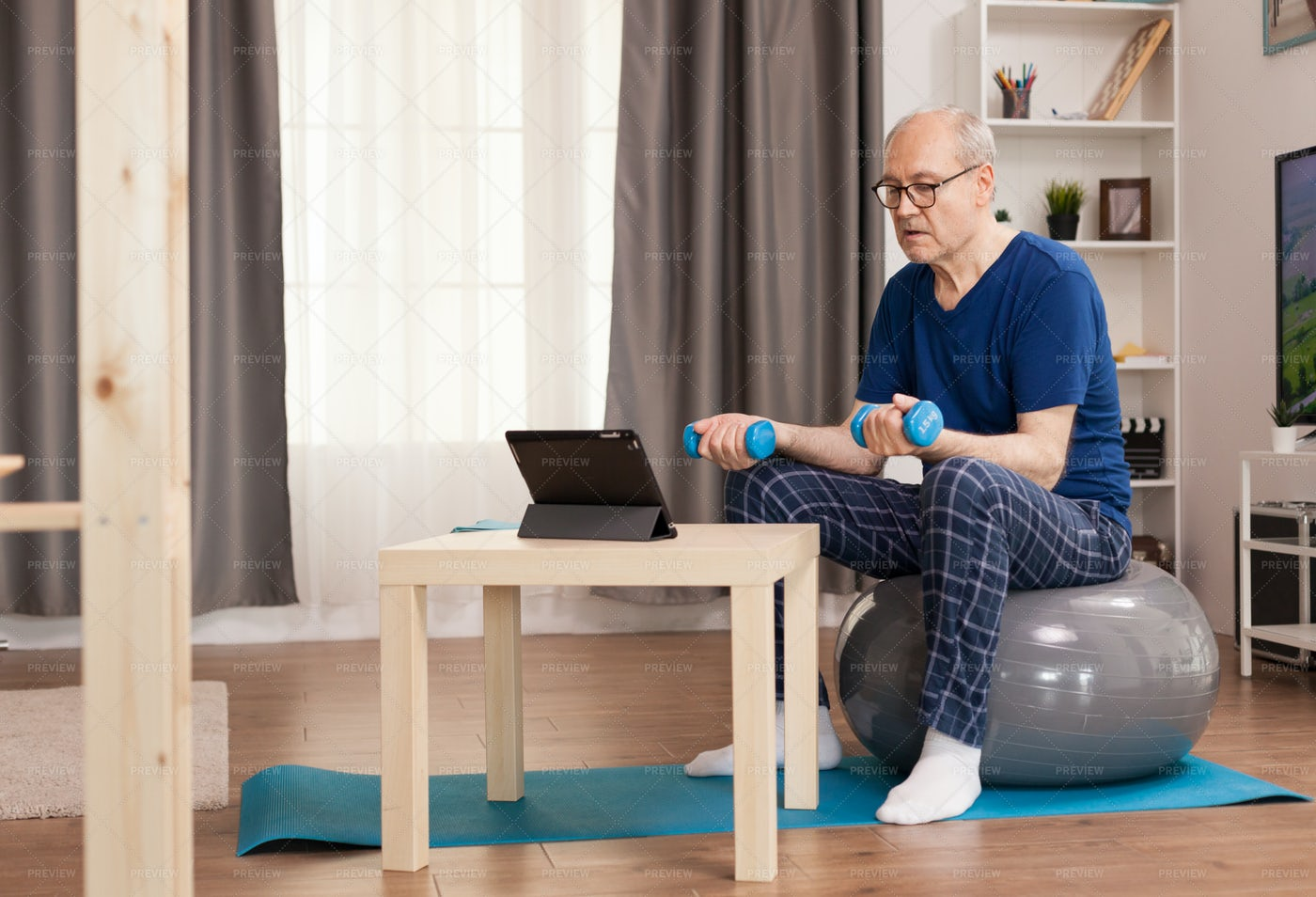 Retired Person Doing Sports At Home: Stock Photos