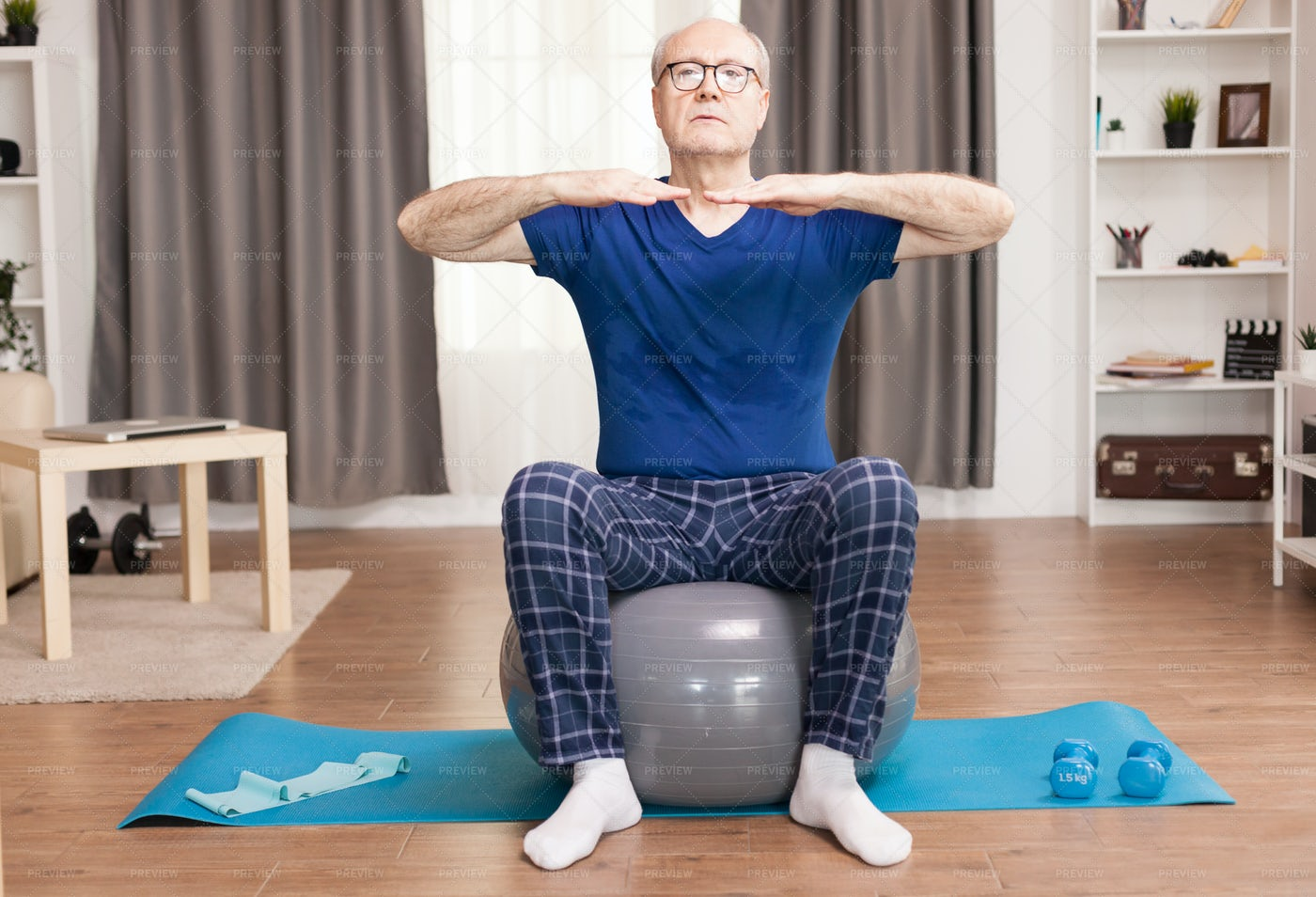 Senior Man Training On Stability Ball: Stock Photos