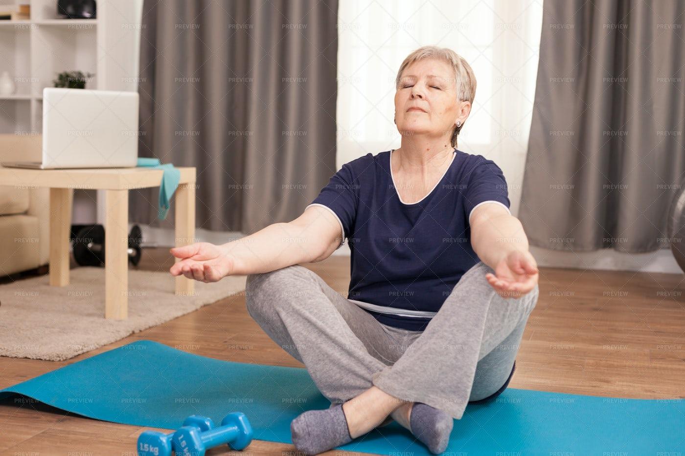 Peaceful Senior Woman Doing Yoga: Stock Photos