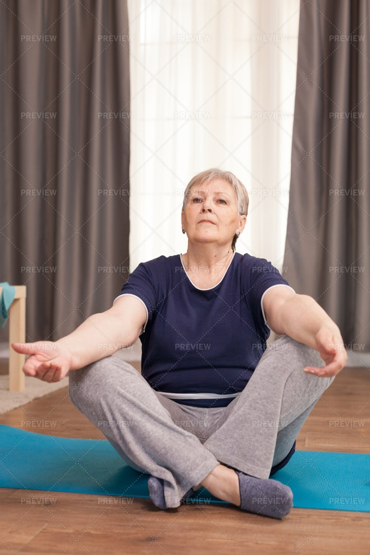 Portrait Of Old Woman Practicing Yoga: Stock Photos