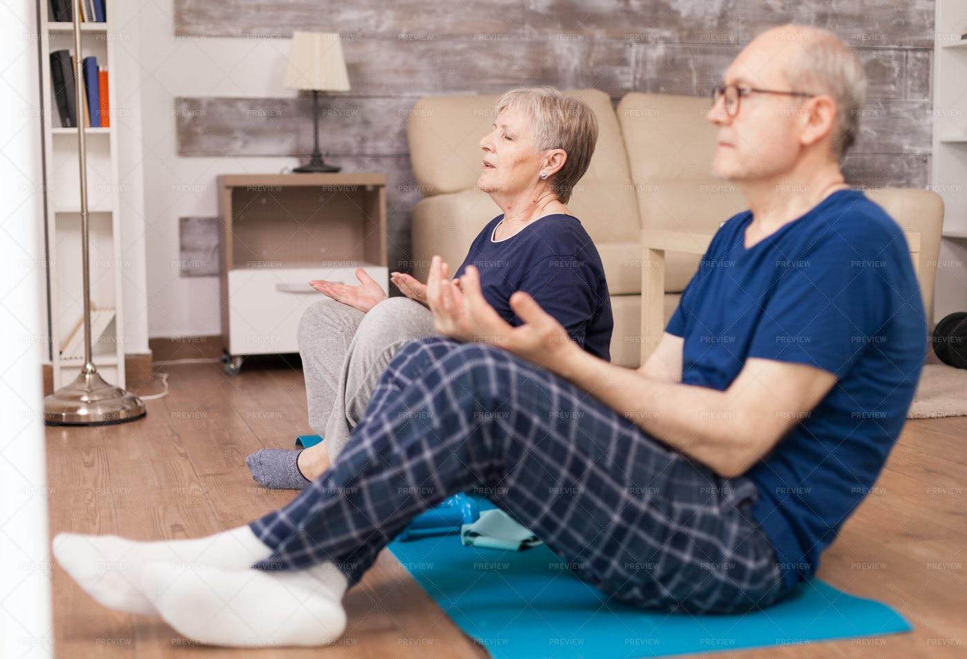 Eldery Couple Practice Yoga: Stock Photos