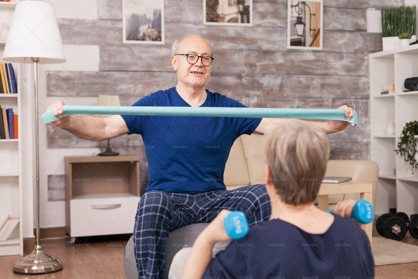 Elderly Man Using Bands: Stock Photos