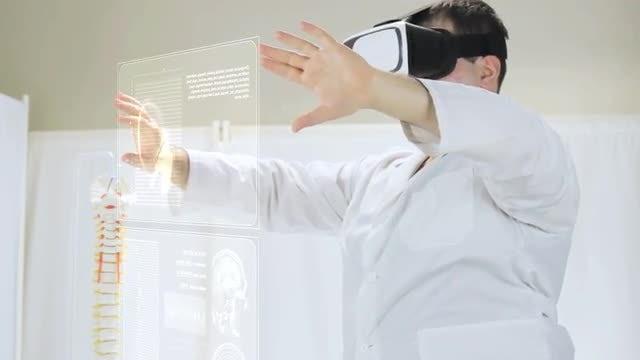 Doctor Studies Virtual Patient Data: Stock Video
