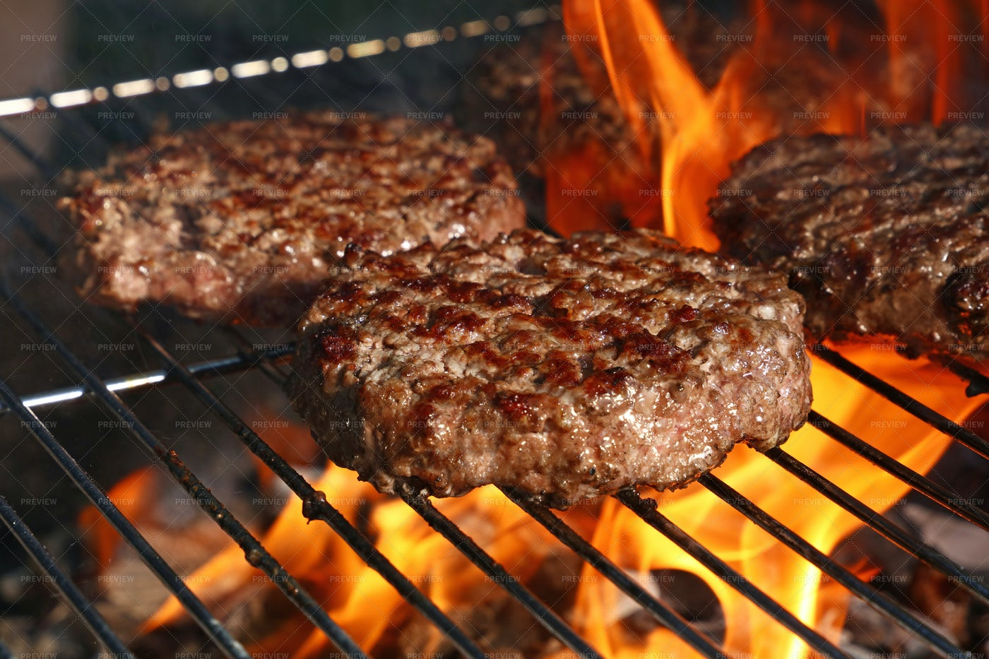Burgers On A Fiery Grill: Stock Photos