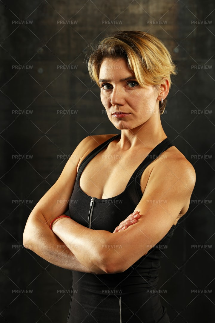 Athletic Woman Folds Arms: Stock Photos