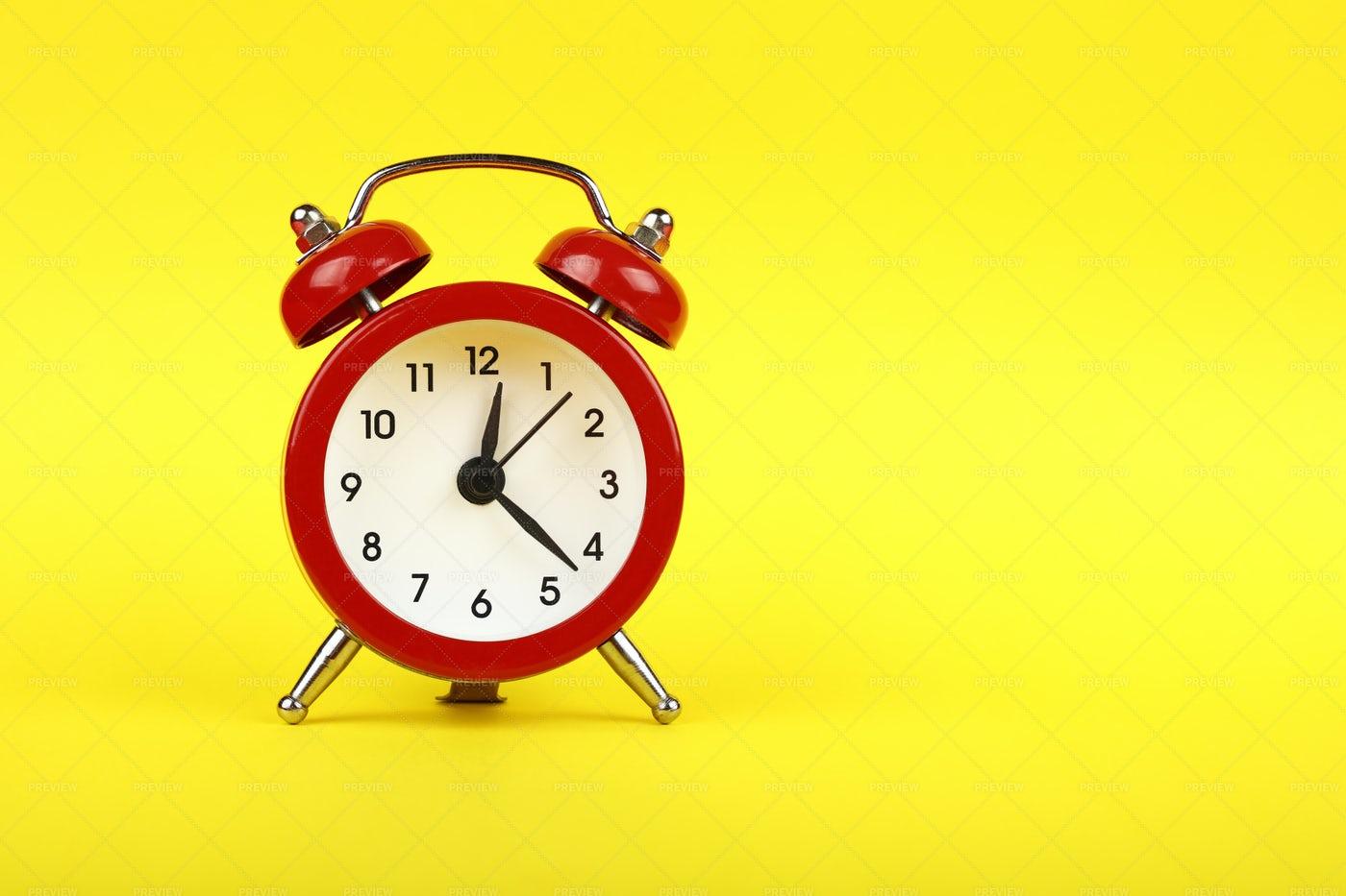Red Alarm Clock On Yellow: Stock Photos