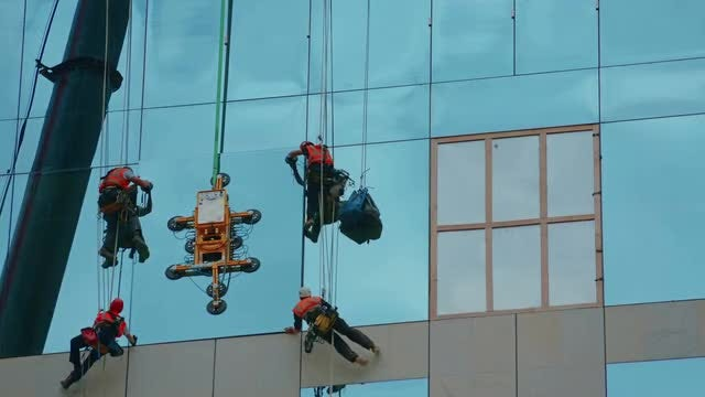 Installing Glass Pane On Building: Stock Video