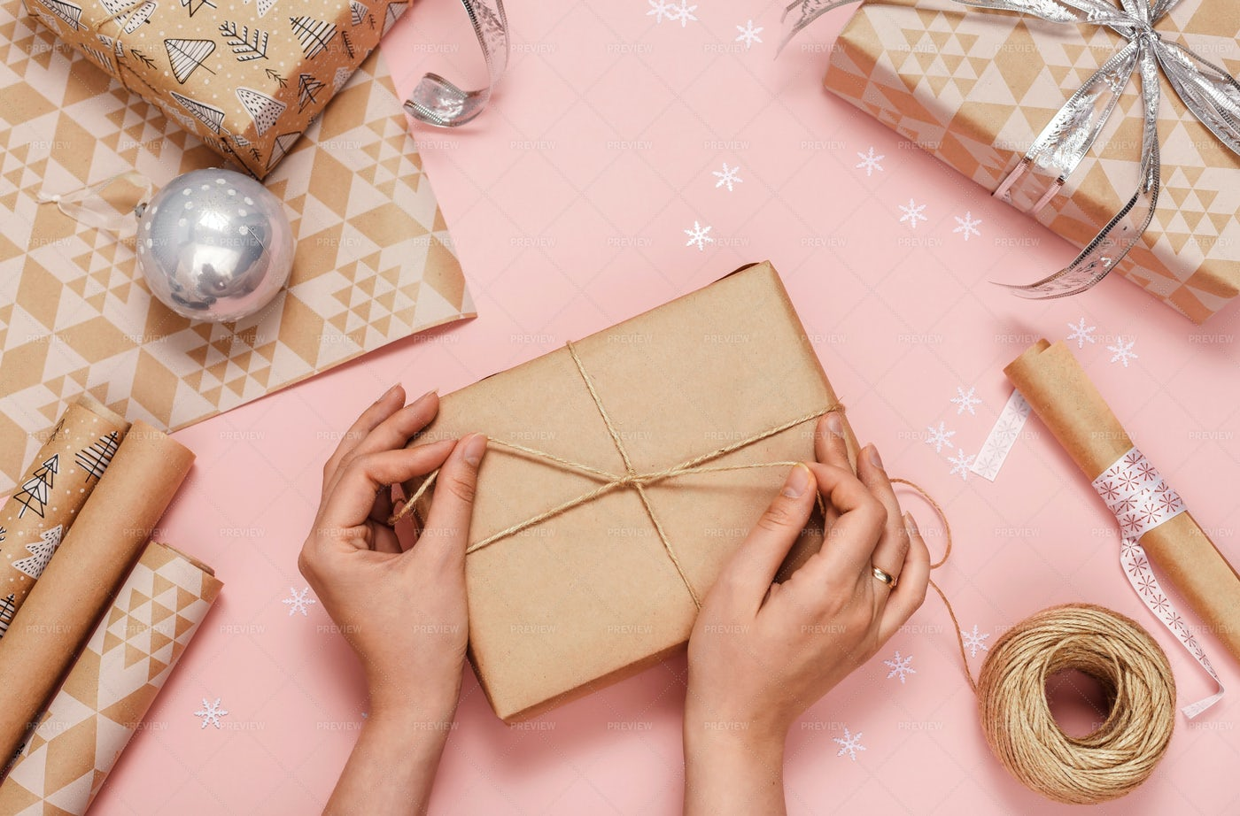 Hands Wrapping Gifts: Stock Photos