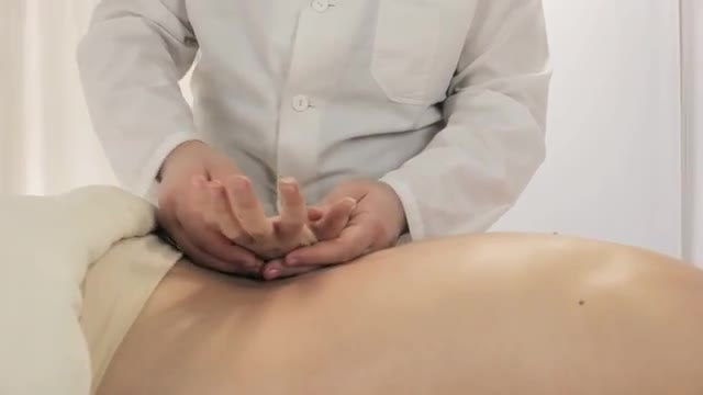 Professional Masseur Massaging Young Woman: Stock Video