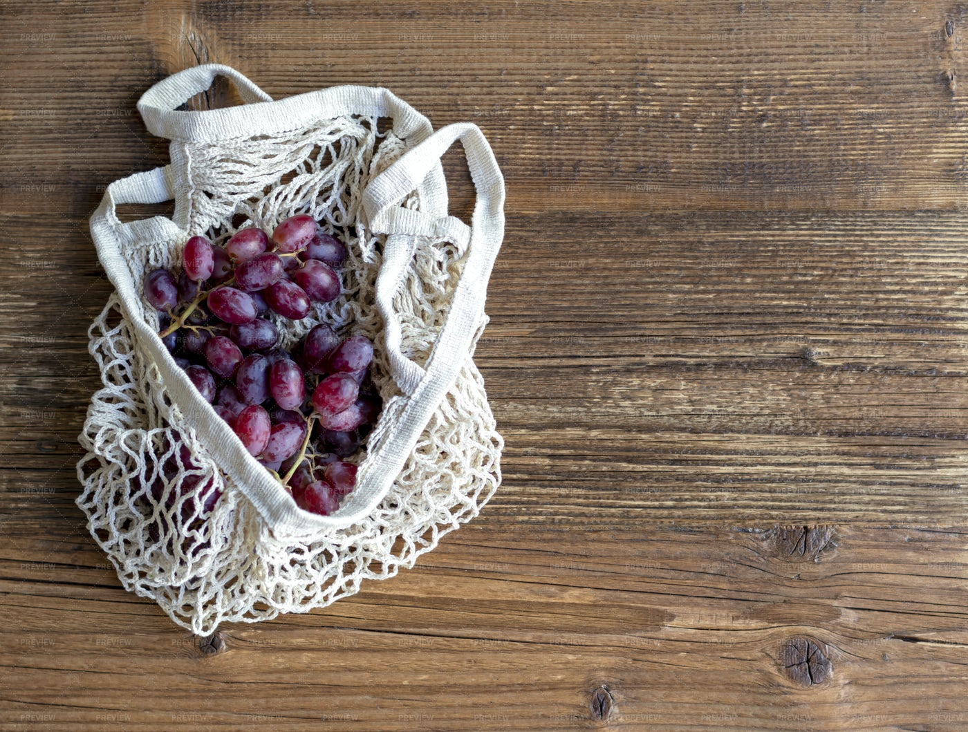 Red Grapes In A String Bag: Stock Photos