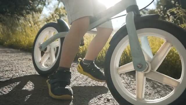 Little Boy On A Bike: Stock Video