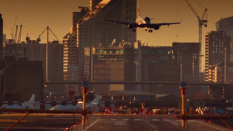 Airplane Landing At Busy Airport: Stock Video