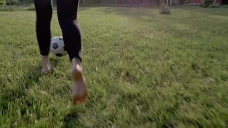 Young Woman Playing Soccer On Grass: Stock Video