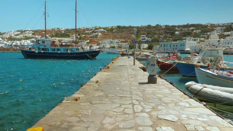 Walking Through Mykonos Port: Stock Video