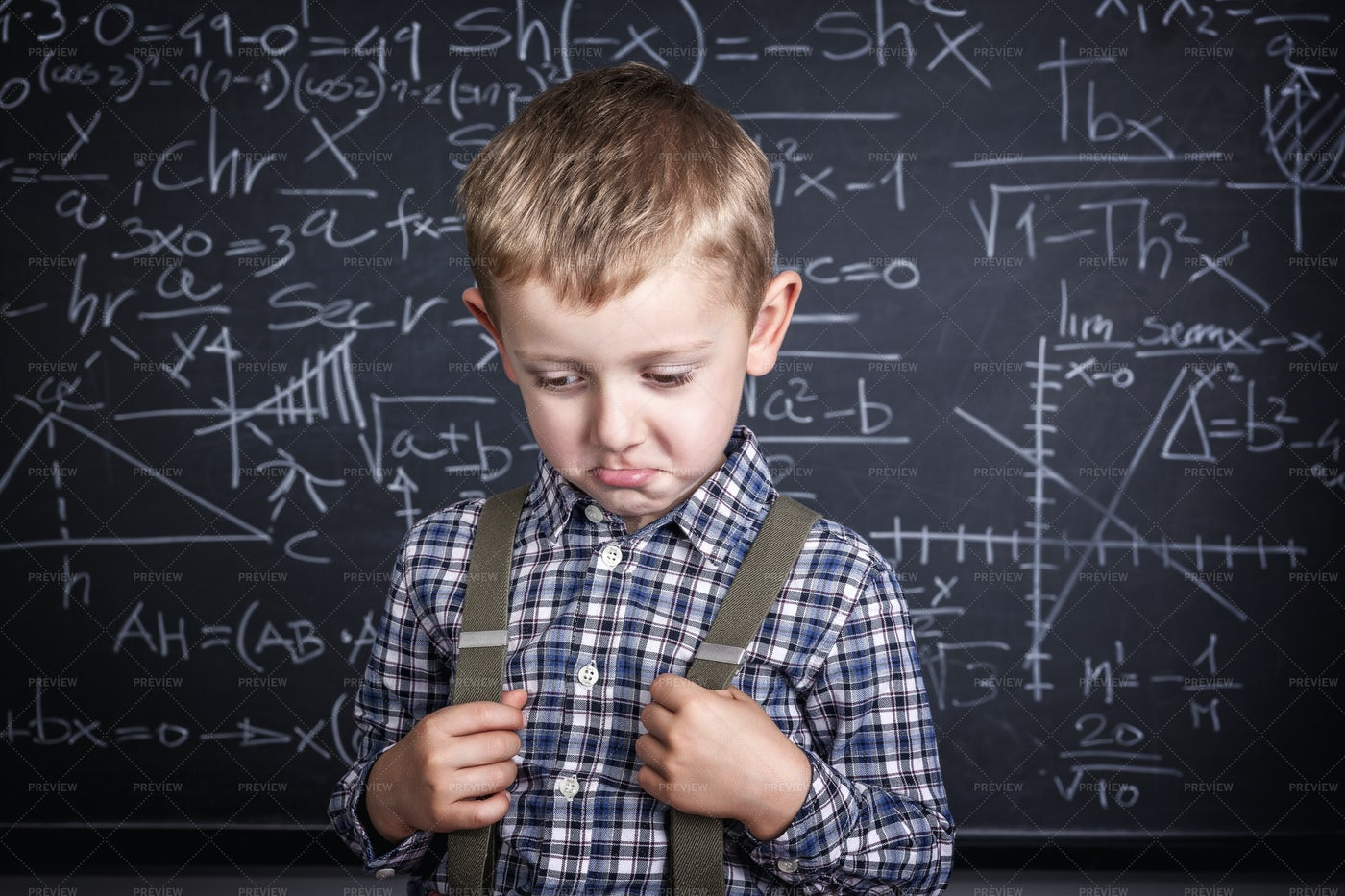 Frustrated School Boy And Blackboard: Stock Photos