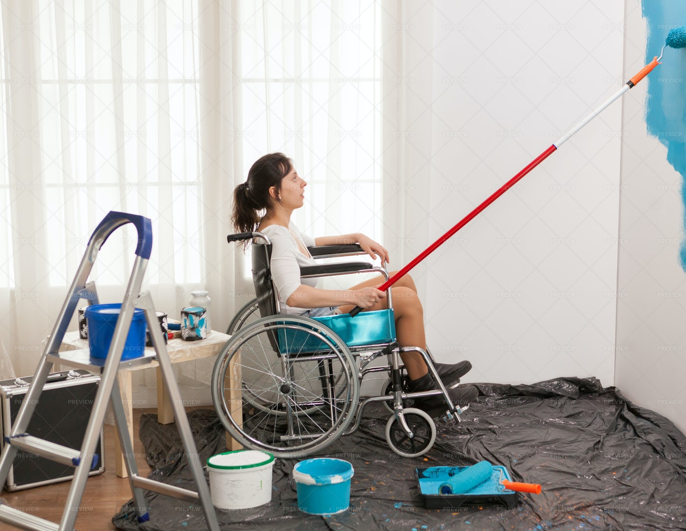 Paralyzed Woman Renovating: Stock Photos