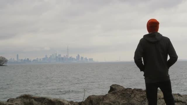 Man Looks At Toronto: Stock Video