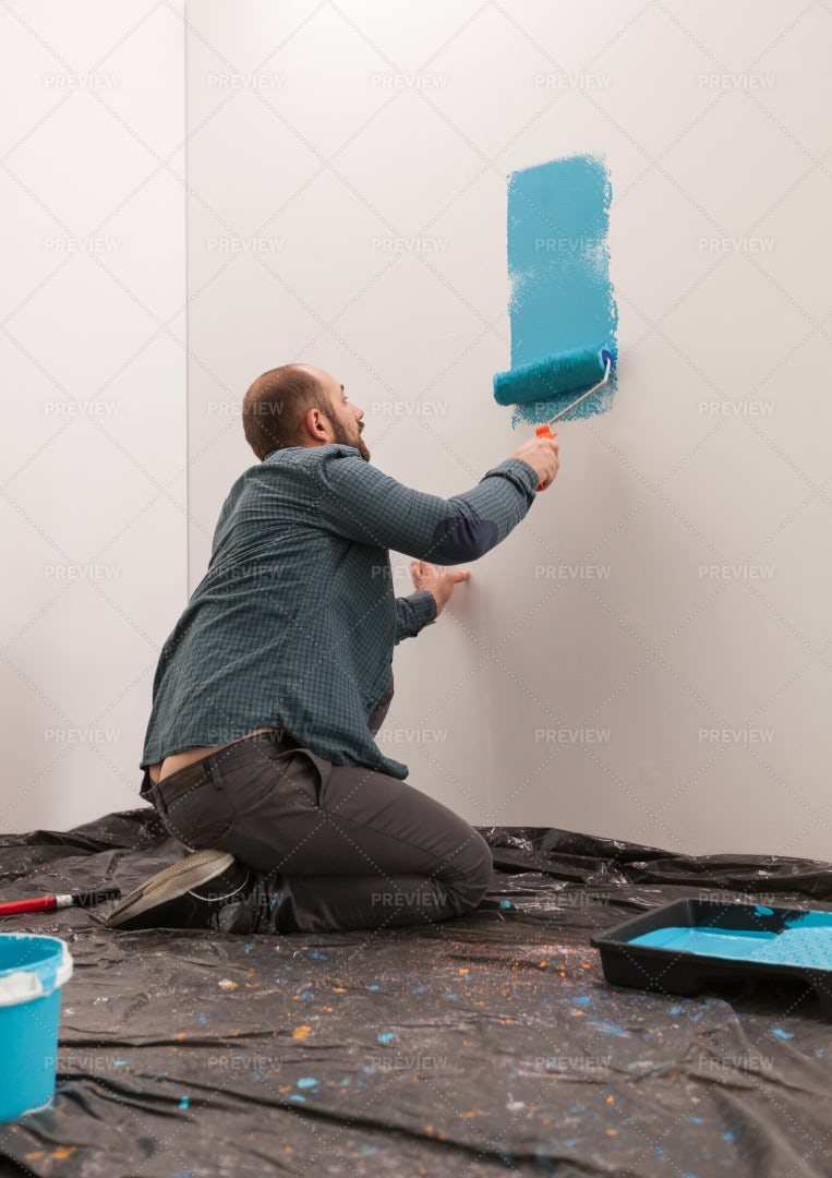 Painting Wall With Roller: Stock Photos