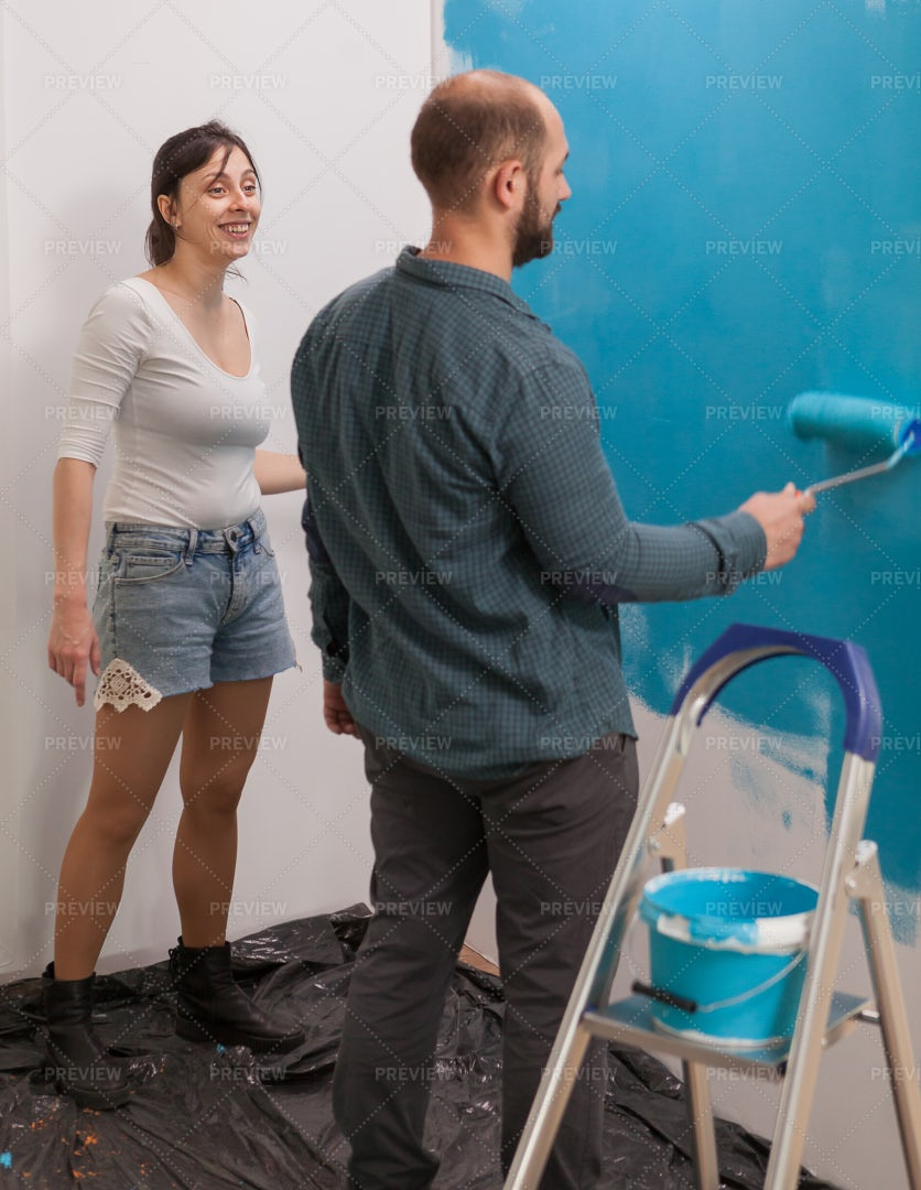 Happy Couple Painting: Stock Photos