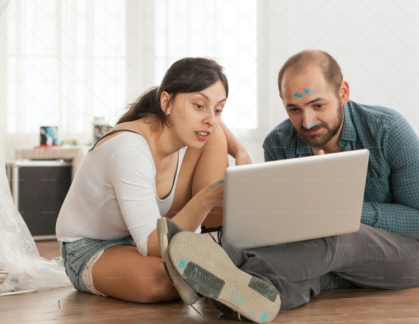 Browsing While Home Decorating: Stock Photos
