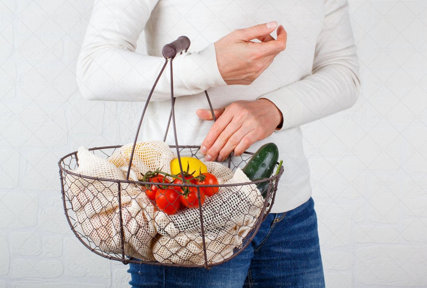 Reaching Into The Basket: Stock Photos