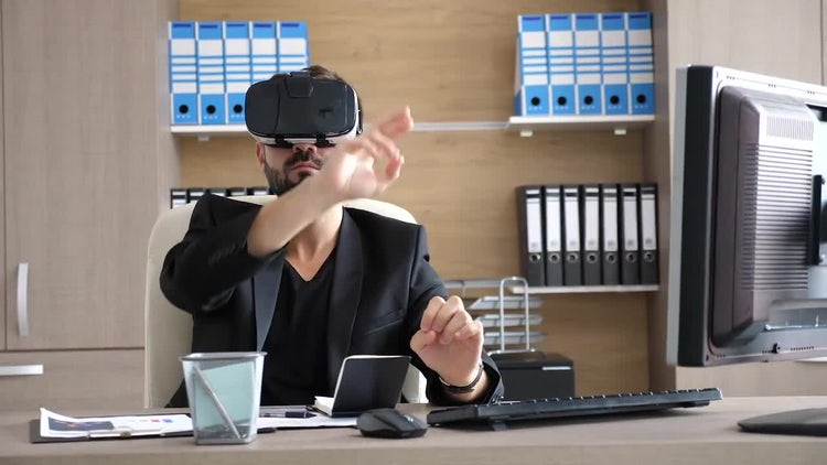 Businessman Tries Out Virtual Reality: Stock Video