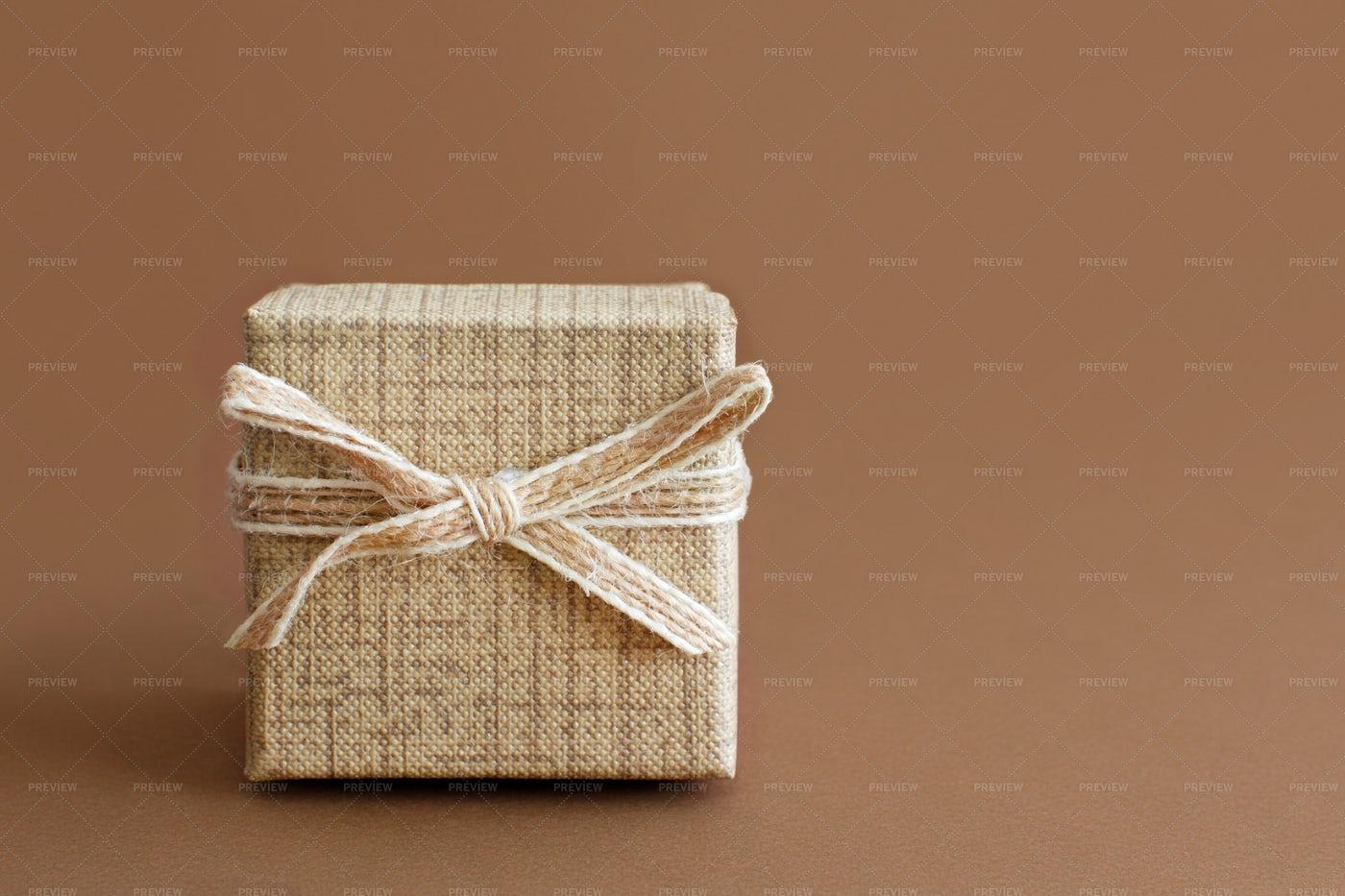 Cream Gift Box On Brown: Stock Photos