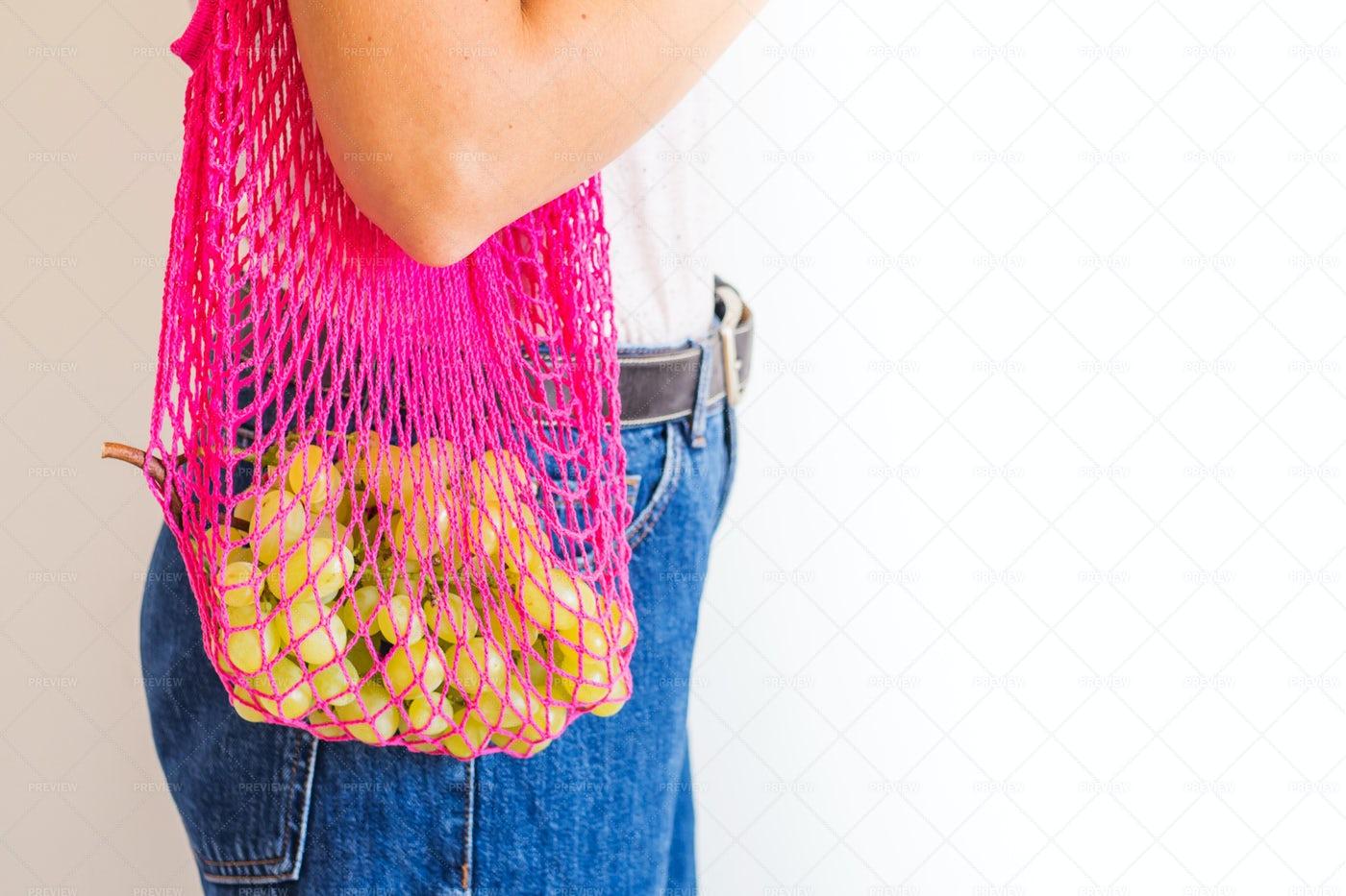 Grapes In A Mesh Bag: Stock Photos