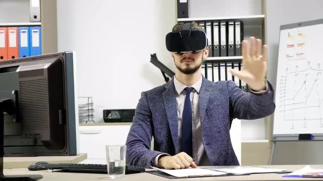 Wearing VR Headset At Work: Stock Video