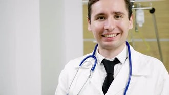 Smiling Male Doctor With Stethoscope : Stock Video