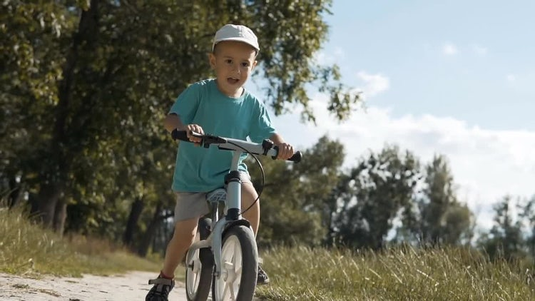 Little Boy Enjoys Bike Ride: Stock Video