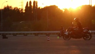 Motorcycle Driving Lessons At Sunset: Stock Footage