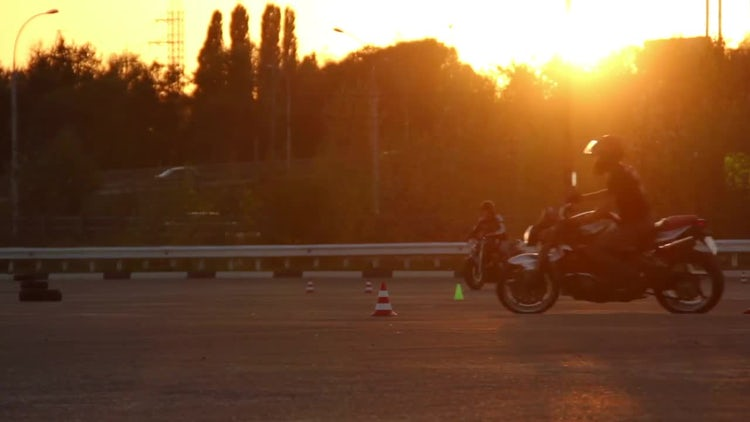 Motorcycle Driving Lessons At Sunset: Stock Video