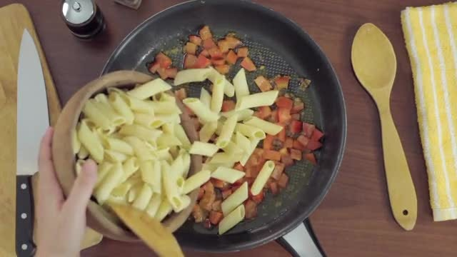 Adding Pasta To Frying Pan: Stock Video