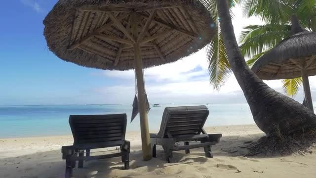 Chaise Longue On Deserted Beach: Stock Video