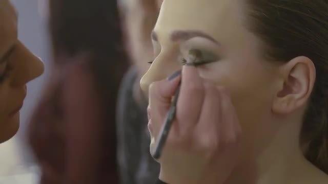 Makeup Artist Applying Eyeliner: Stock Video