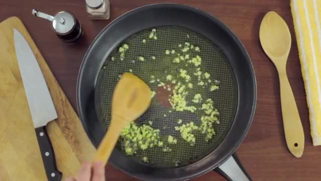 Cooking Garlic In Frying Pan: Stock Video