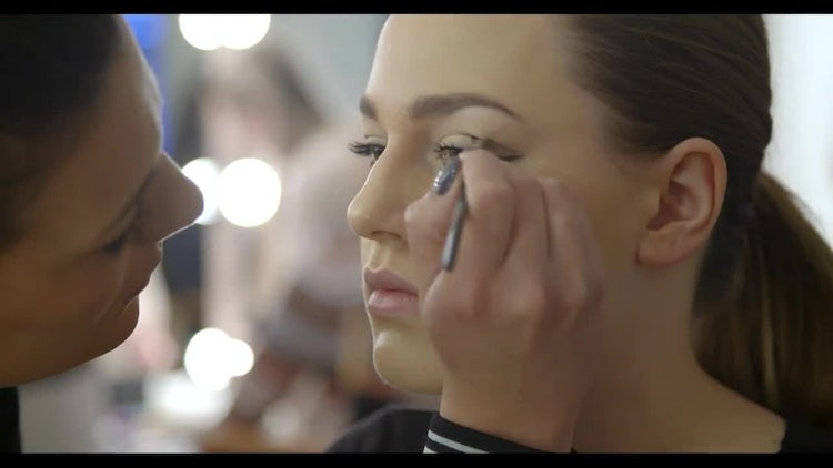 Makeup Artist Applying Eye Liner: Stock Video