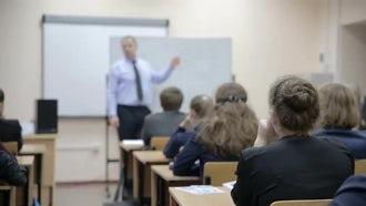 Teacher Teaching Students In Class: Stock Video