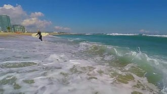 Surfer Walking Out Of Ocean: Stock Footage